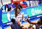 Kansas guard Latrell Jossell (4) elevates to the bucket before being called for a charge during the second half on Thursday, Dec. 3, 2020 at Allen Fieldhouse.