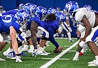 Kansas football players line up and prepare for a snap during a spring practice on April 9, 2021, in the Jayhawks' indoor practice facility.
