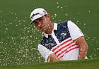 Gary Woodland watches his shot out of a bunker on the second hole during the second round of the Masters golf tournament on Friday, April 9, 2021, in Augusta, Ga.
