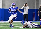 Kansas running back Amauri Pesek-Hickson looks to evade defenders during a spring practice at the Jayhawks' indoor facility in April of 2021.
