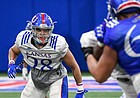 Kansas inside linebacker Taiwan Berryhill surveys the field in front of him during a spring practice at the Jayhawks' indoor facility.