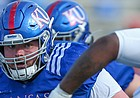Kansas center Colin Grunhard looks in the direction of defensive lineman Caleb Sampson during the Jayhawks' practice on April 15, 2021.