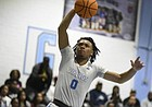 New Kansas basketball signee Bobby Pettiford Jr., soars through the air for a bucket during his playing days at South Granville High.