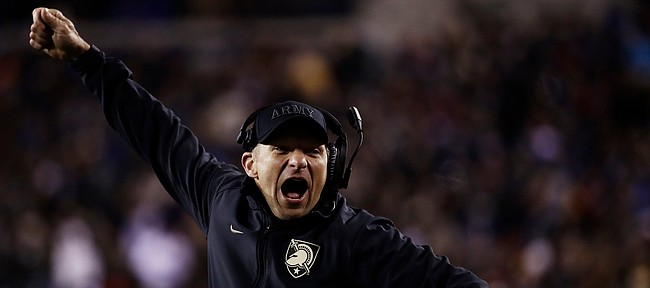 FILE — Army head coach Jeff Monken cheers during the second half an NCAA college football game against Navy, on Saturday, Dec. 8, 2018, in Philadelphia. Army won 17 -10. (AP Photo/Matt Rourke)