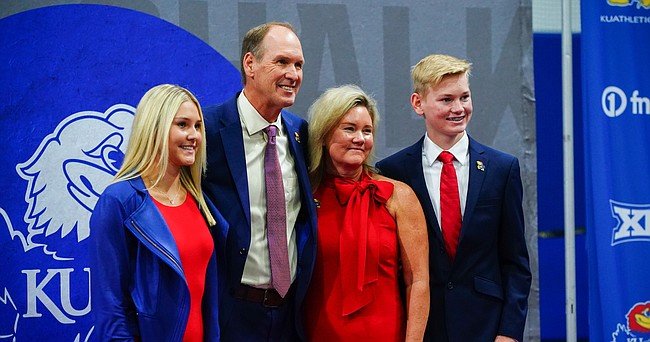 New Kansas head football coach Lance Leipold stands for a few photos with his wife Kelly, daughter Lindsey and son Landon following his introductory press conference on Monday, May 3, 2021 at the KU football indoor practice facility.
