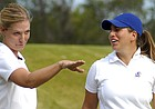 KU womens golf coach Erin O'Neil, left, visits with KU golfer Annie Giangrosso, as Giangrosso waits to tee off at the 2006 Marilynn Smith Sunflower Invitational.