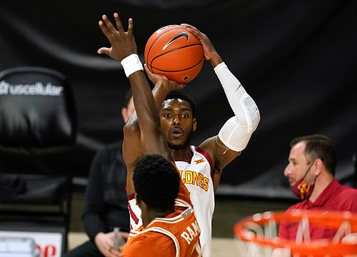 Iowa State guard Jalen Coleman-Lands shoots a 3-point basket over Texas guard Courtney Ramey (3) during the second half of an NCAA college basketball game, Tuesday, March 2, 2021, in Ames, Iowa. Texas won 81-67.