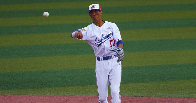 KU freshman Maui Ahuna fires to first base during a KU game in the 2021 season. Ahuna recently earned honorable mention all-Big 12 honors and was named to the Big 12's all-tournament team.