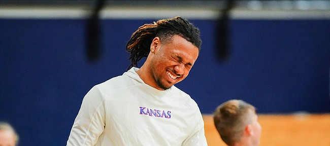 Kansas newcomer Bobby Pettiford laughs as he works with campers at Washburn head coach Brett Ballard's basketball camp on Wednesday, June 9, 2021 at Lee Arena in Topeka.