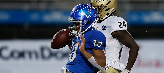 In this AP file photo, former Buffalo Bulls receiver Trevor Wilson — who announced on May 30, 2021, his decision to transfer to the University of Kansas — scores a touchdown during the second half of an NCAA college football game in Amherst, N.Y., Saturday, Dec. 12, 2020. (AP Photo/Jeffrey T. Barnes)