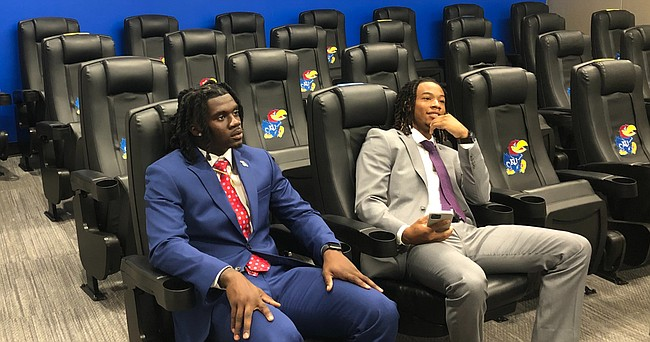 Kansas football players Kenny Logan Jr., left, and Kwamie Lassiter II sit inside the team auditorium while waiting for virtual media sessions at Big 12 Media Days to begin on Thursday, July 15, 2021. Lassister and Logan missed out on the opportunity to be in Dallas with the rest of the conference's representatives because of bad weather grounding their flight.