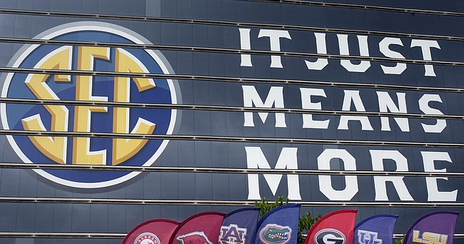 The SEC logo is displayed at the Hyatt Regency hotel, site of the NCAA college football Southeastern Conference Media Days, Monday, July 19, 2021, in Hoover, Ala.