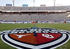 """In this Oct. 10, 2020, file photo, The Red River Showdown logo is displayed on the field of the Cotton Bowl, prior to an NCAA college football game between the University of Texas and Oklahoma, in Dallas. Texas and Oklahoma made a request Tuesday, July 27, 2021, to join the Southeastern Conference — in 2025 —- with SEC Commissioner Greg Sankey saying the league would consider it in the """"near future."""""""