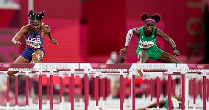 Christina Clemons of the United States and Tobi Amusan, right, of Nigeria, compete in a women's 100-meter hurdles semifinal at the 2020 Summer Olympics, Sunday, Aug. 1, 2021, in Tokyo.