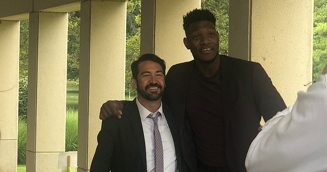 Former KU basketball player Silvio De Sousa, right, celebrates with his attorney Hatem Chahine, left, outside Douglas County District Court after a jury found De Sousa not guilty of aggravated battery on Aug. 5, 2021.