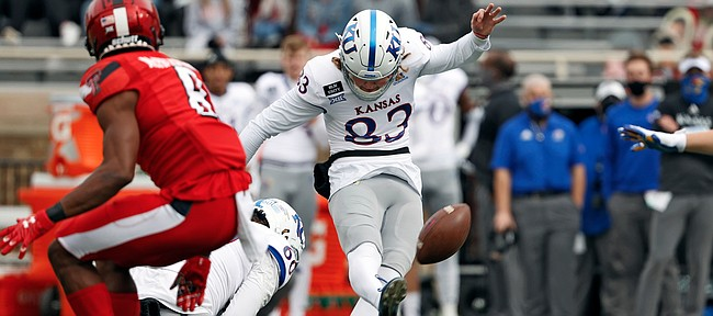 Kansas' Jacob Borcila (83) kicks a field goal during the first half of an NCAA college football game Saturday, Dec. 5, 2020, in Lubbock, Texas. (AP Photo/Brad Tollefson)