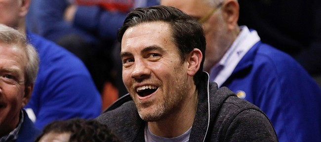 Jayhawk great and former Oklahoma City Thunder forward, Nick Collison smiles as he watches from behind the bench during the second half on Monday, Feb. 24, 2020 at Allen Fieldhouse.