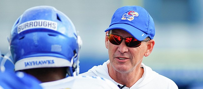 Kansas head coach Lance Leipold talks with safety OJ Burroughs during practice on Saturday, Aug. 14, 2021 at Memorial Stadium.