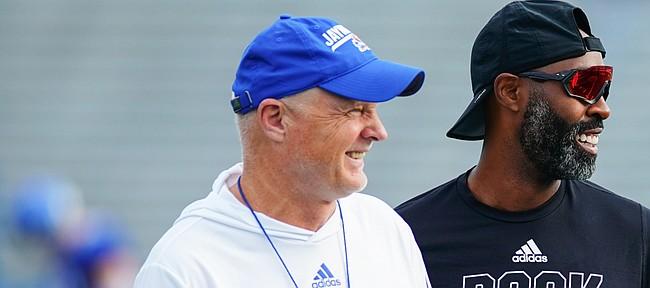 Kansas defensive coordinator Brian Borland, left, and cornerbacks coach Chevis Jackson have a laugh during practice on Saturday, Aug. 14, 2021 at Memorial Stadium.