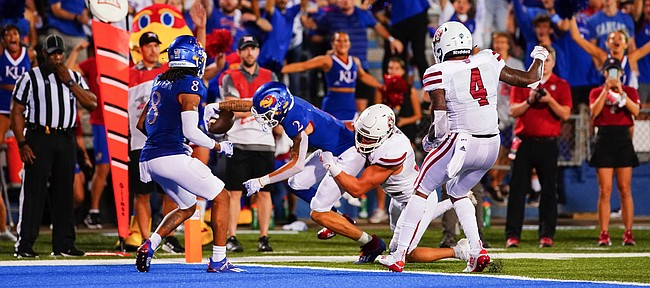 Kansas wide receiver Lawrence Arnold (2) reaches the ball into the end zone for what proved to be the winning touchdown late in the fourth quarter on Friday, Sept. 3, 2021 at Memorial Stadium. (Photo by Nick Krug/Special to the Journal-World)
