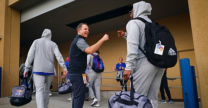Kansas athletic director Travis Goff greets members of the football team with fist bumps as they head to the locker room prior to kickoff against South Dakota on Friday, Sept. 4, 2021 outside the Anderson Family Football Complex. (Photo by Nick Krug/Special to the Journal-World)