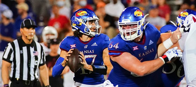 Kansas quarterback Jason Bean (17) drops back to sling a touchdown pass to the end zone during the second quarter on Friday, Sept. 3, 2021 at Memorial Stadium. (Photo by Nick Krug/Special to the Journal-World)
