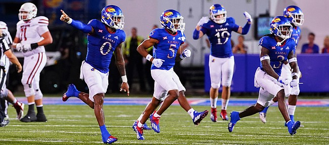 The Kansas defense celebrates a turnover on downs during the fourth quarter on Friday, Sept. 3, 2021 at Memorial Stadium. (Photo by Nick Krug/Special to the Journal-World)