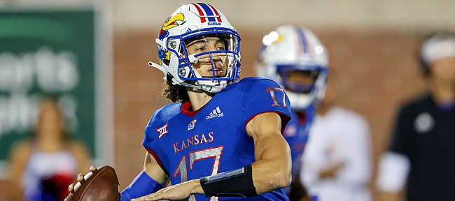 Kansas quarterback Jason Bean looks for a receiver during the first half of the team's NCAA college football game against Coastal Carolina in Conway, S.C., Friday, Sept. 10, 2021. (AP Photo/Nell Redmond)