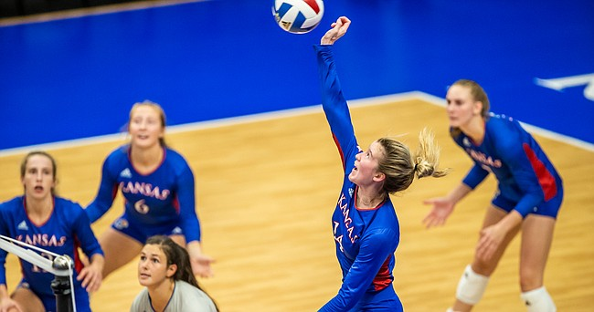 Kansas freshman Caroline Bien (14) swings at a ball during the Jayhawks sweep of Kent State on Saturday, Sept. 11, 2021 at Horejsi Family Volleyball Arena.