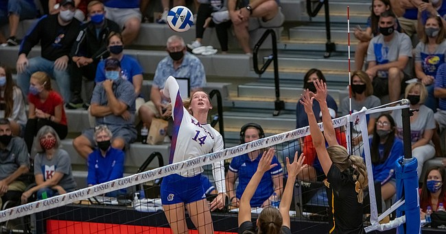 Kansas freshman Caroline Bien swings at a ball during the Jayhawks' home sweep of Wichita State on Friday, Sept. 10, 2021 at Horejsi Family Volleyball Arena.