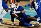 Kansas running back Devin Neal (4) gets up after scoring a touchdown against Coastal Carolina during the first half of an NCAA college football game in Conway, S.C., Friday, Sept. 10, 2021. (AP Photo/Nell Redmond)