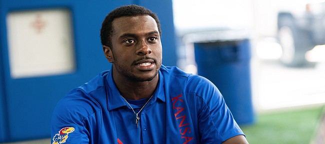 Kansas defensive end Kyron Johnson talks with media members during interview on Tuesday, Aug. 17, 2021 at the Indoor Practice Facility.