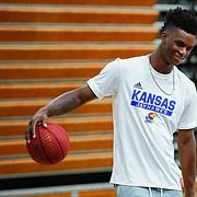 Kansas newcomer KJ Adams jokes with campers at Washburn head coach Brett Ballard's basketball camp on Wednesday, June 9, 2021 at Lee Arena in Topeka.