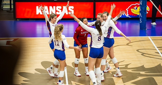 The Kansas Jayhawks celebrate a point late in their match victory over the Kansas City Roos on Thursday, Sept. 16, 2021, at Horejsi Family Volleyball Arena.