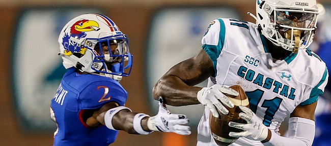 Coastal Carolina wide receiver Kameron Brown, right, catches a pass next to Kansas cornerback Jacobee Bryant during the first half of an NCAA college football game in Conway, S.C., Friday, Sept. 10, 2021. (AP Photo/Nell Redmond)
