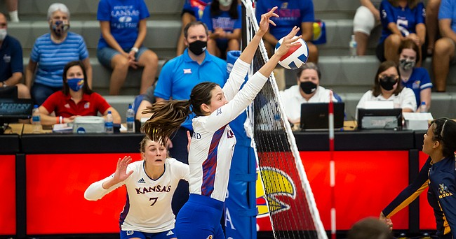 Middle blocker Caroline Crawford eats up a Kansas City Roos attack during the Jayhawks' four-set win on Thursday, Sept. 16, 2021 at Horejsi Family Volleyball Arena.