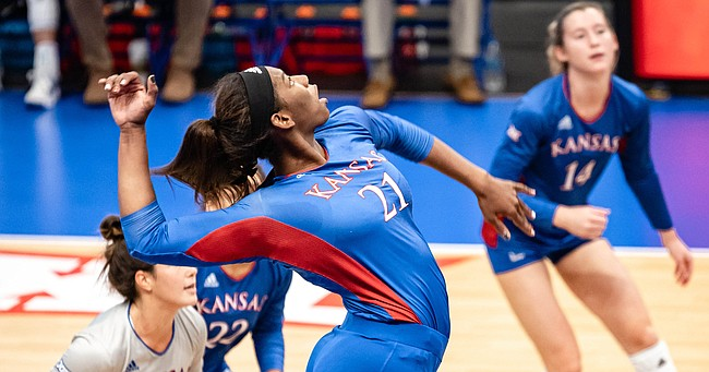 Kansas freshman London Davis swings at a ball during the Jayhawks' sweep of Albany in the final match of the Jayhawk Classic on Saturday, Sept. 18, 2021.