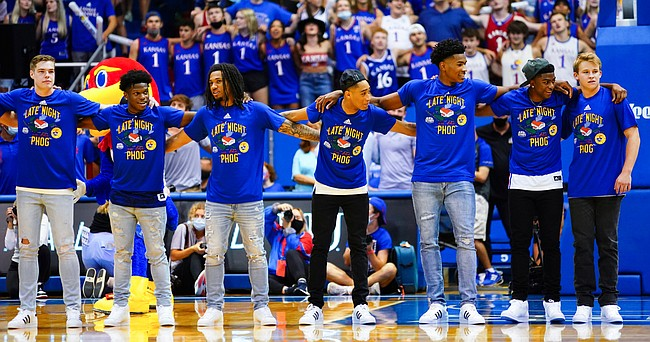 Members of the men's basketball team come together to sing the Alma Mater during Late Night in the Phog, Friday, Oct. 1, 2021 at Allen Fieldhouse.