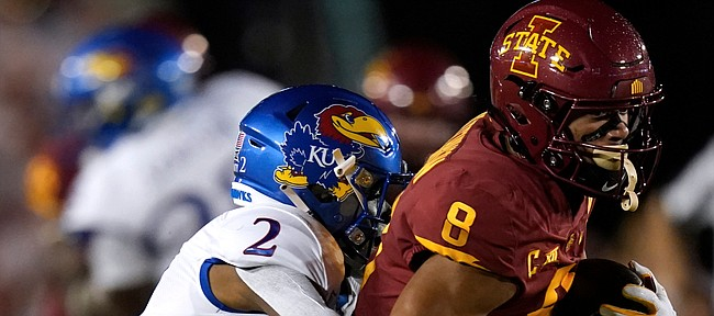 Iowa State wide receiver Xavier Hutchinson (8) tries to break a tackle by Kansas cornerback Jacobee Bryant (2) after catching a pass during the first half of an NCAA college football game, Saturday, Oct. 2, 2021, in Ames, Iowa. (AP Photo/Charlie Neibergall)