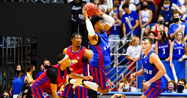 Kansas Jayhawks guard Remy Martin (11) gets up to throw a pass during the Late Night in the Phog scrimmage, Friday, Oct. 1, 2021 at Allen Fieldhouse.
