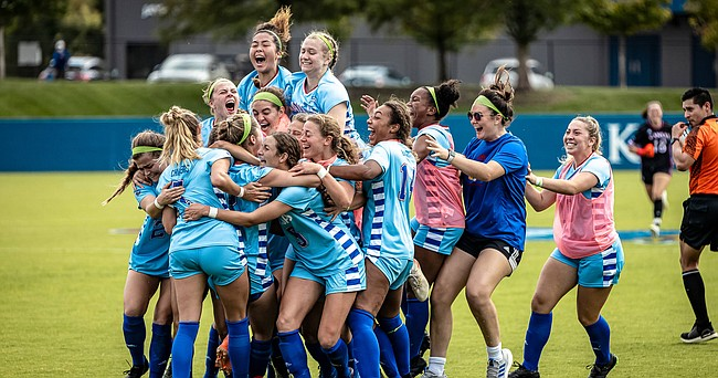 The Kansas women's soccer team celebrates its 2-1, double-overtime victory over No. 9 West Virginia on Sunday, Oct. 10, 2021, at Rock Chalk Park.