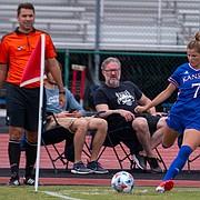 Raena Childers takes a corner kick for Kansas soccer.