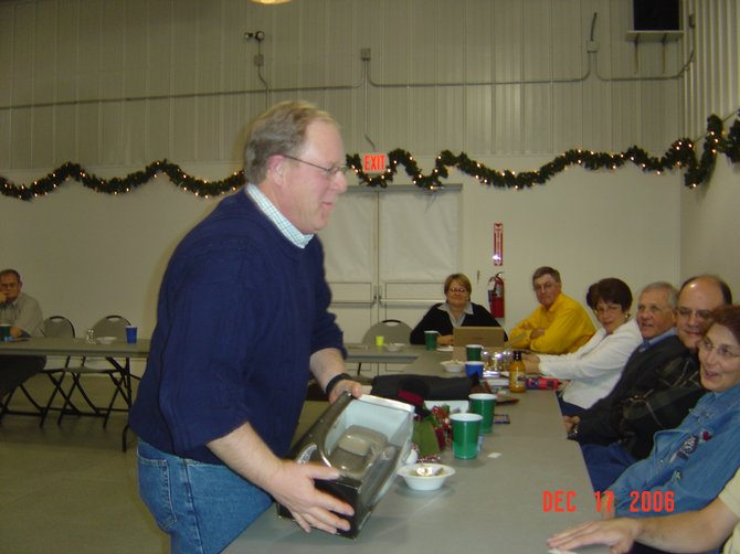 b) Gregg Colburn, Vice-President