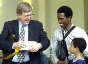 Francis Collins, head of the National Health Institutes Human Genome Project, signs an autograph for Alex Hall, 8, of Lawrence, KS. Friday, May 5, 2000, during Collins visit and speech on the genome project at KU. With Alex is his father Ollie Hall. The human genome project is mapping the human gene.