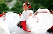 To the strains of traditional Mexican music, Marisa Steinbach, a member of Los Danzantes de St. John's, dances the Los Abanicos, a dance from the Mexican state of Veracruz. The 19th annual St. John's Fiesta Mexicana began Friday night and runs through Saturday night at St. John's School.