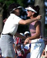 Italy's Stefania Croce, right, congratulates Juli Inkster following Inkster's one stroke win over Croce on the second playoff hole at the LPGA Championship at the DuPont Country Club in Wilmington, Del.