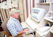 Mike Newberry checks commodity prices online at his Arlington, Ga., farm. Twenty-nine percent of U.S. farms use the Internet, according to a U.S. Department of Agriculture survey.