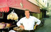 ABC News anchor Peter Jennings pauses in Bethlehem during the shooting in 1998 of his two-hour documentary The Search for Jesus. The film, which airs at 8 p.m. today, retraces the life of the man known in his day as Jesus of Nazareth.