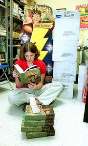Amy Hagedorn checks out the new Harry Potter book Thursday in the storeroom at The Childrens Book Shop at 937 Mass. The book goes public at midnight.