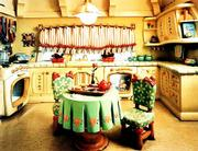 Mickeys Toontown: Minnies Kitchen, a chromogenic color print, by Catherine Wagner.